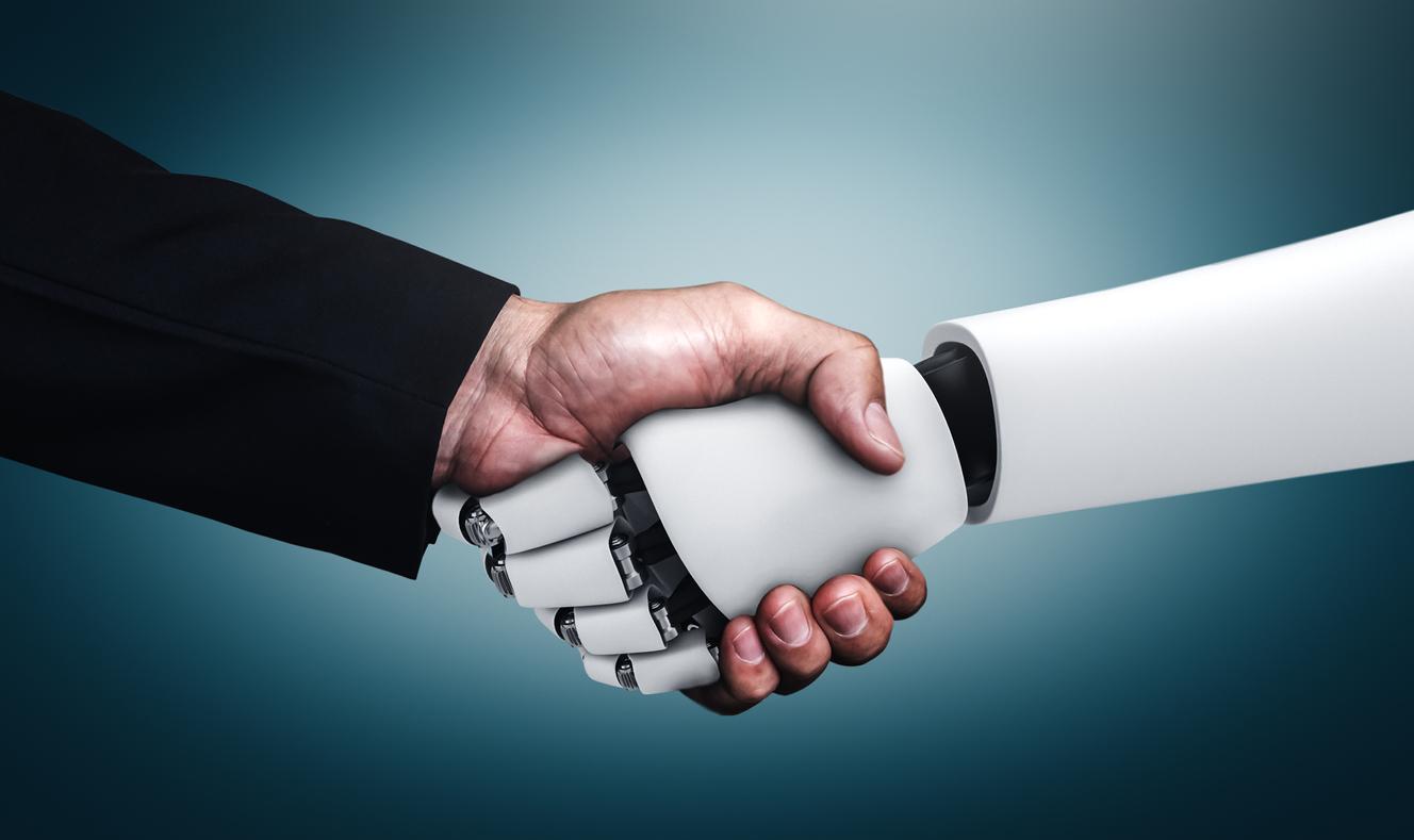människa robot skakar hand